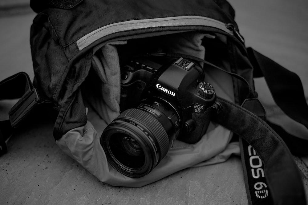 black Canon EOS 6D camera on bag