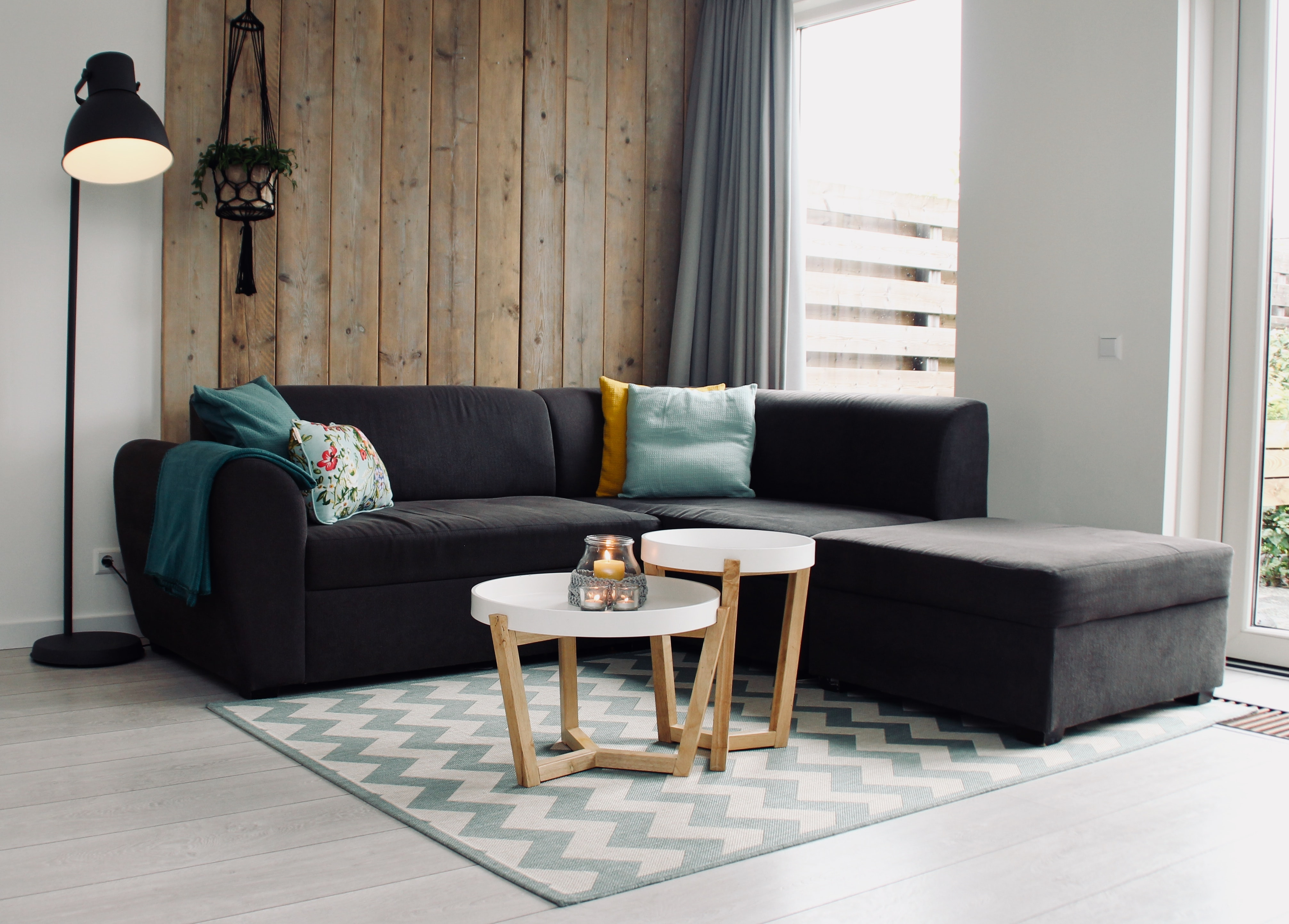 light candle on round white coffee table and sectional sofa
