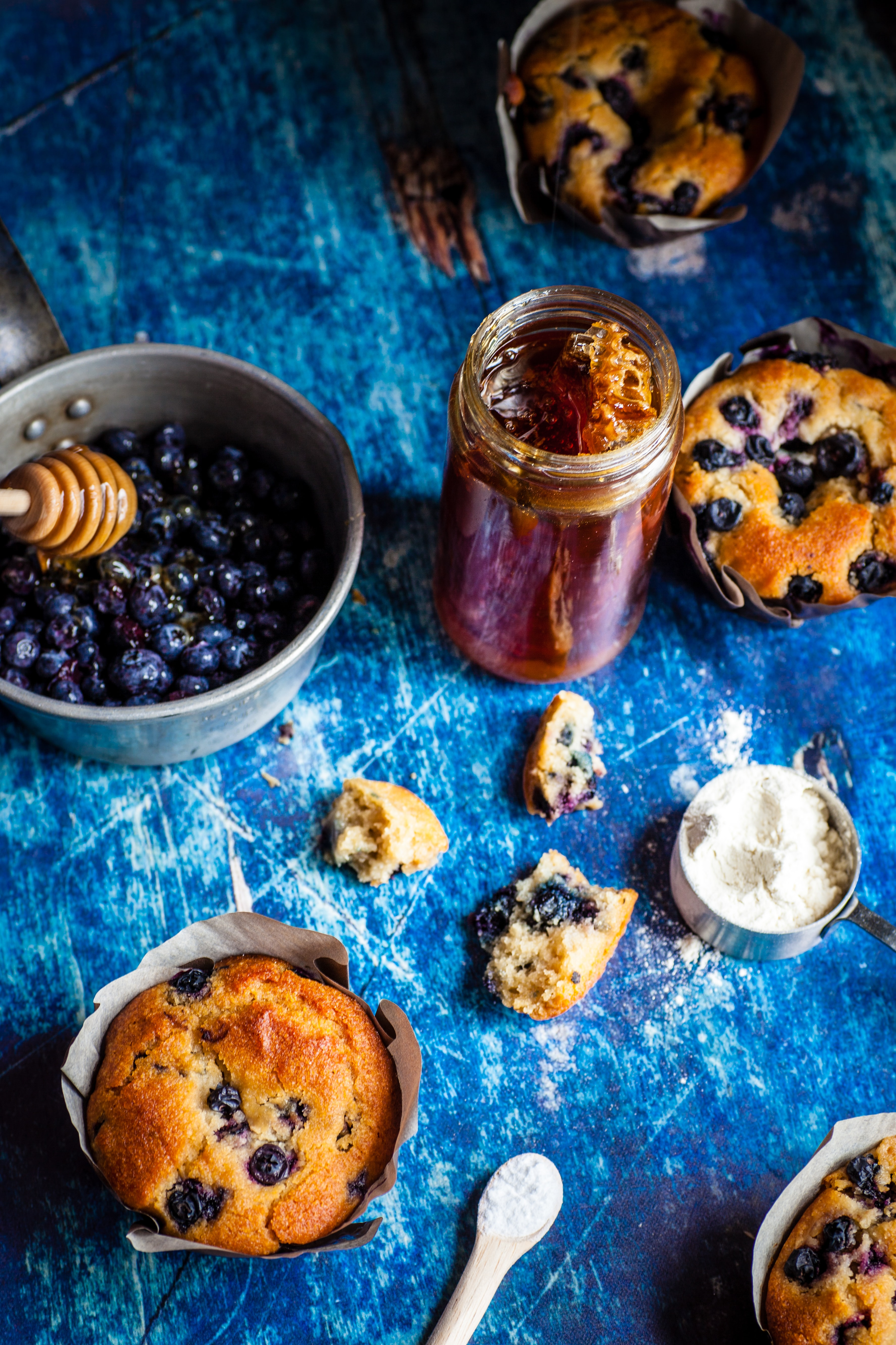 blueberries on gray bowl and muffins