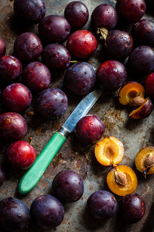 green knife surrounding of fruits