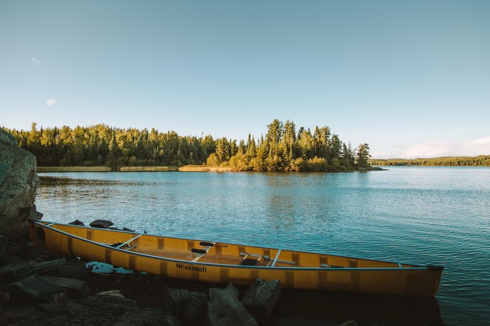 yellow canoe on body of water