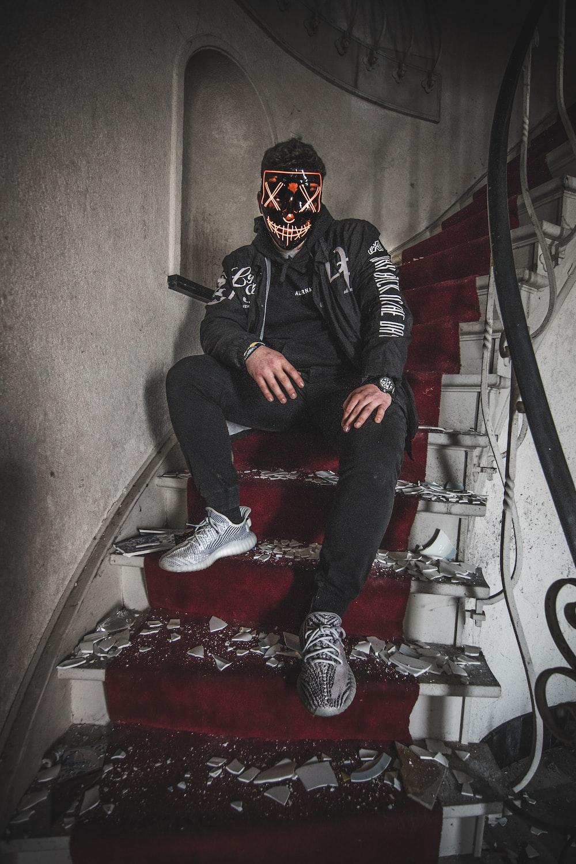 man sitting on stairs