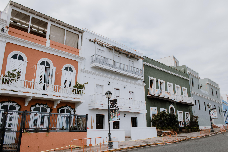 four different color house buildings