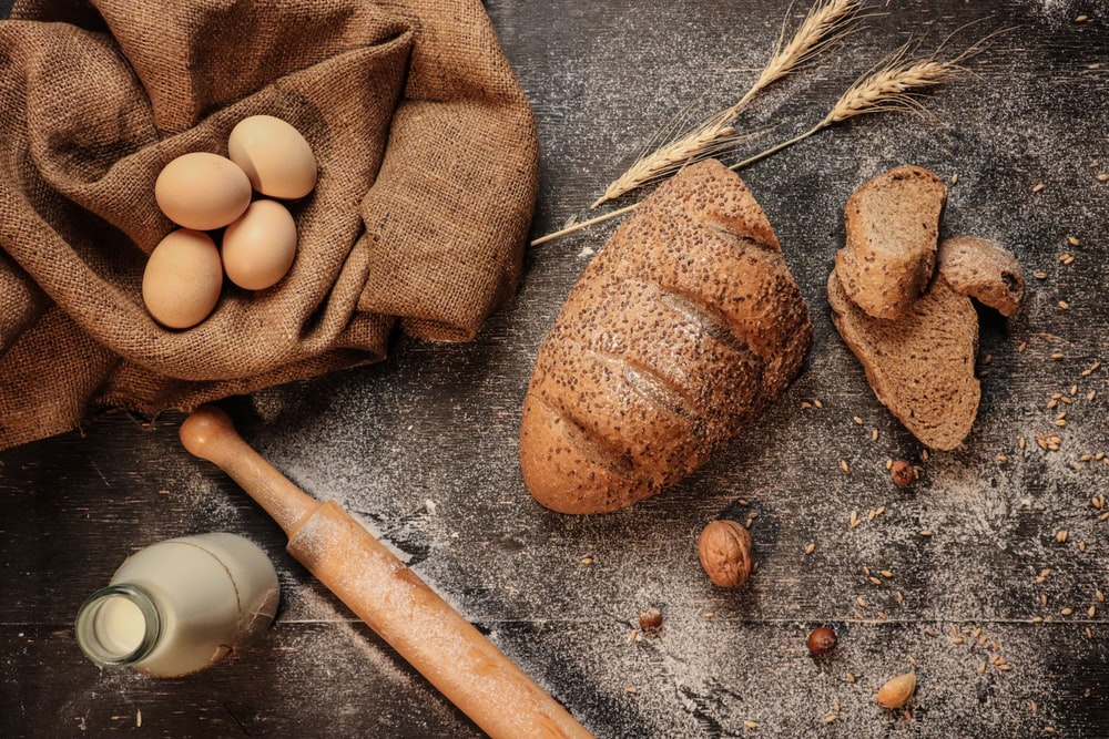 eggs, bread, milk, and rolling pin