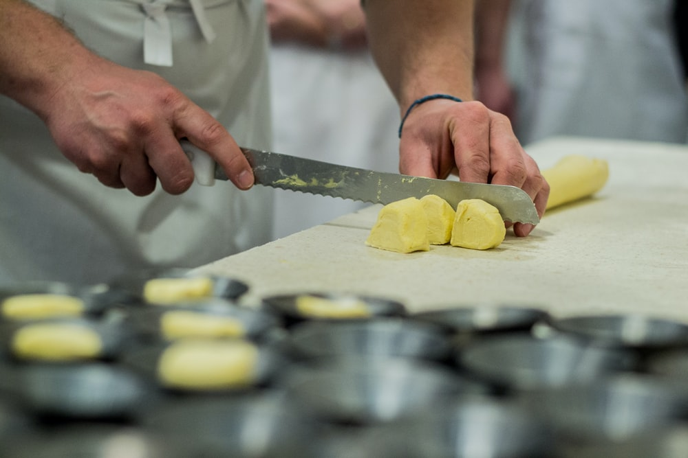 person slicing butter