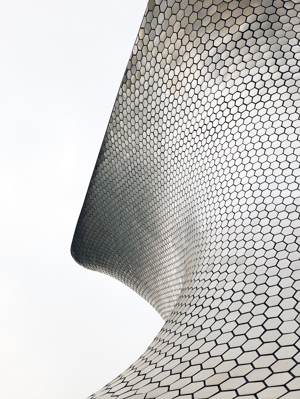 closeup photo of black and gray metal spiral pad