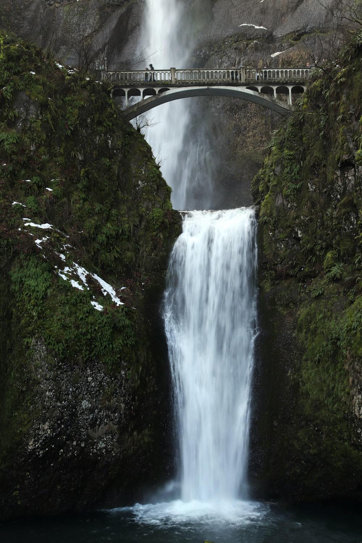 gray bridge over water falls