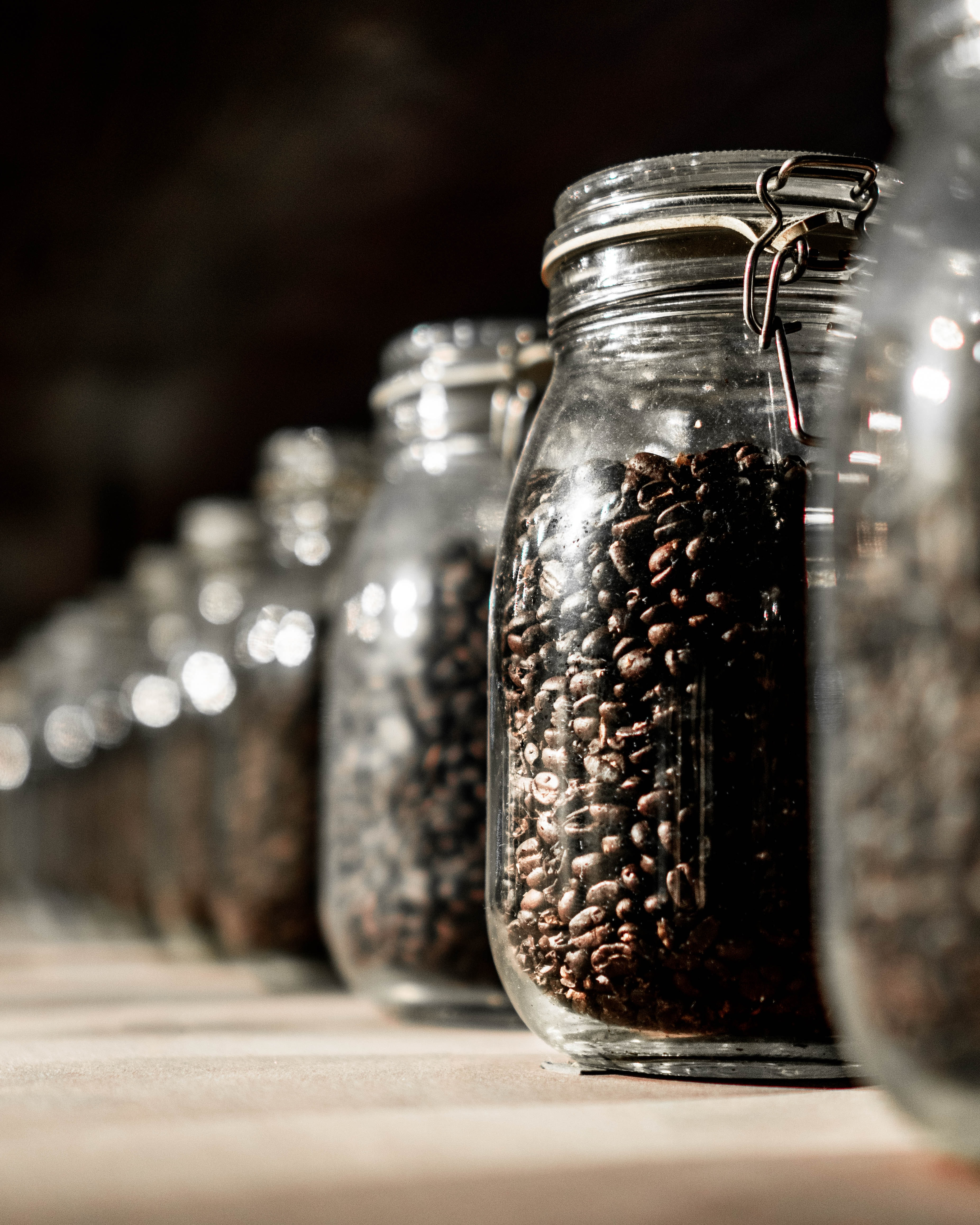 clear glass jar filled with coffee bean lot