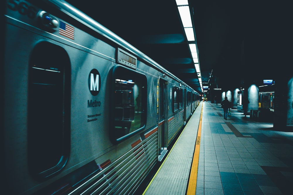 person walking beside train