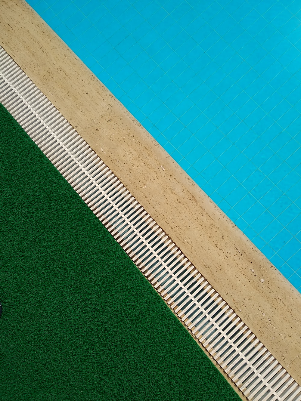 photo of pool and green grass