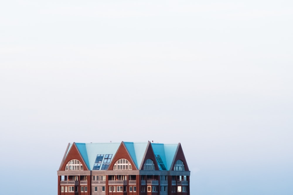 brown and blue house across fogs