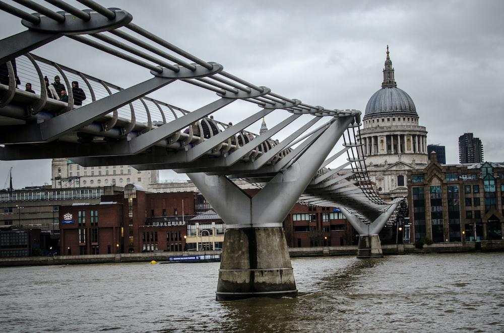 people on bridge during daytime