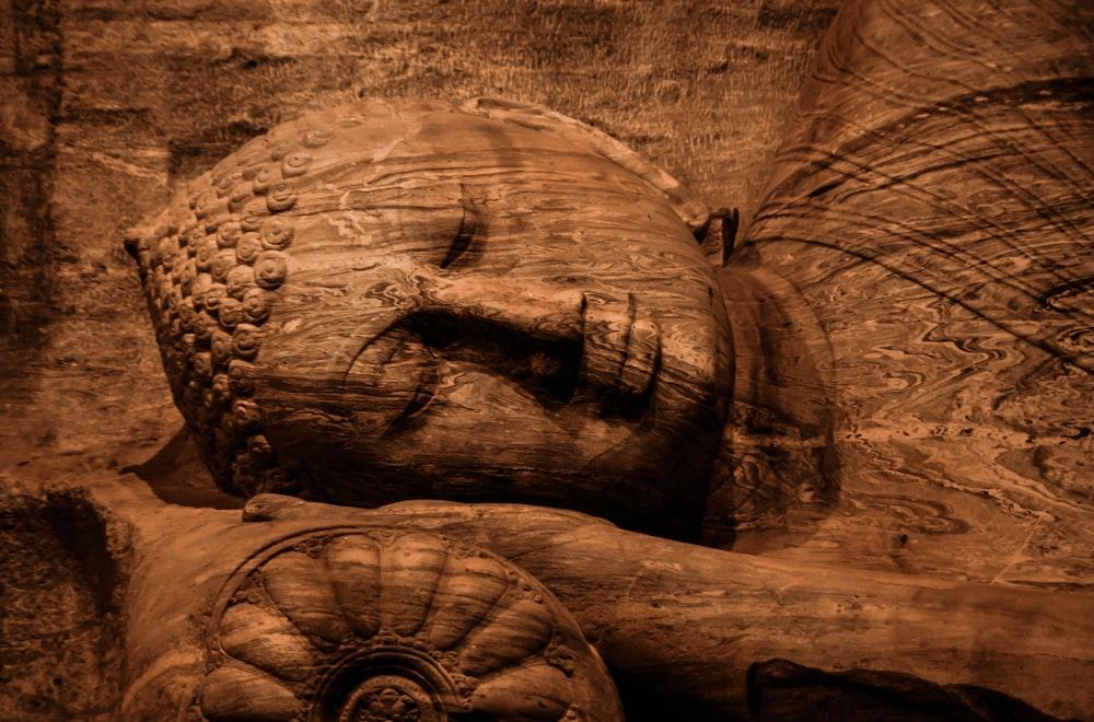 brown buddha sculpture