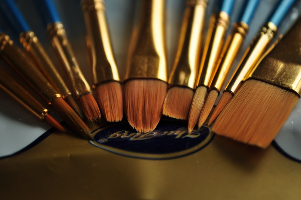 selective focus photography of makeup brush set