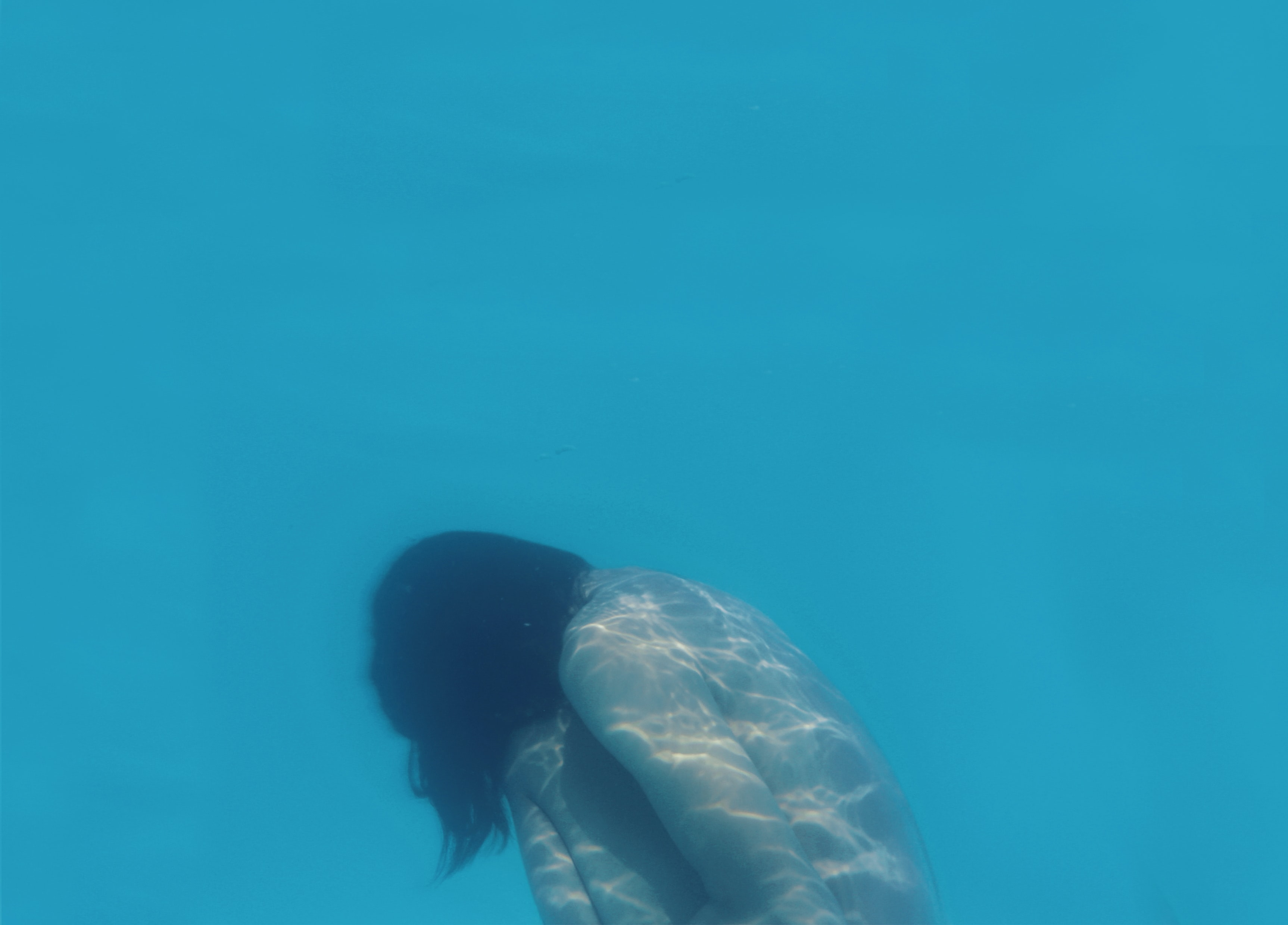 naked woman underwater photo