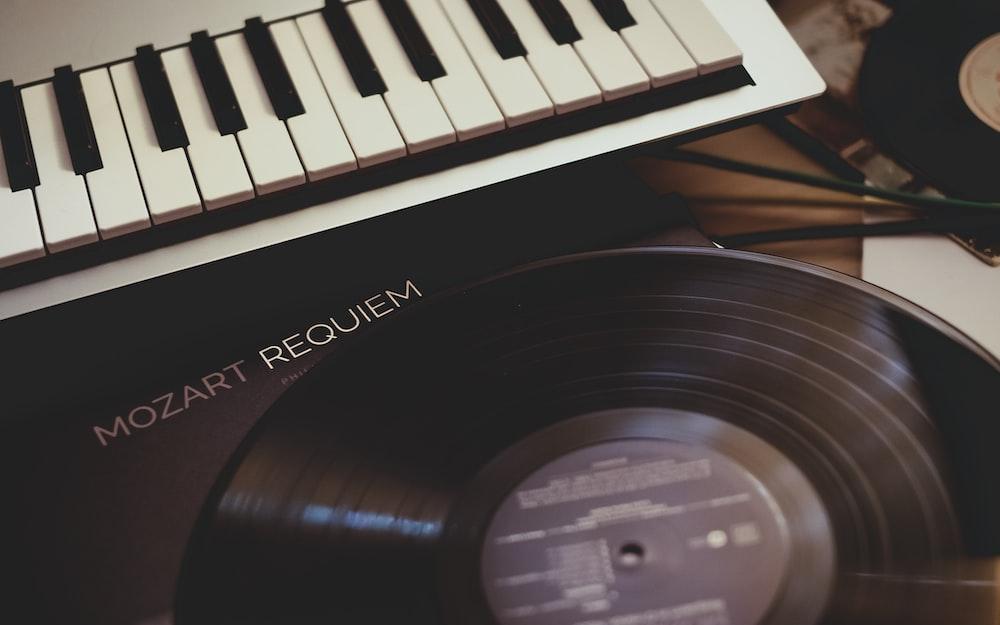 vinyl record near white electronic keyboard