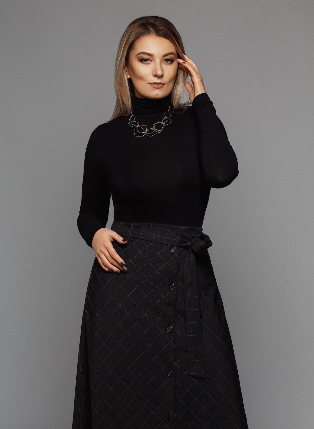 woman wearing black turtleneck long-sleeved dress