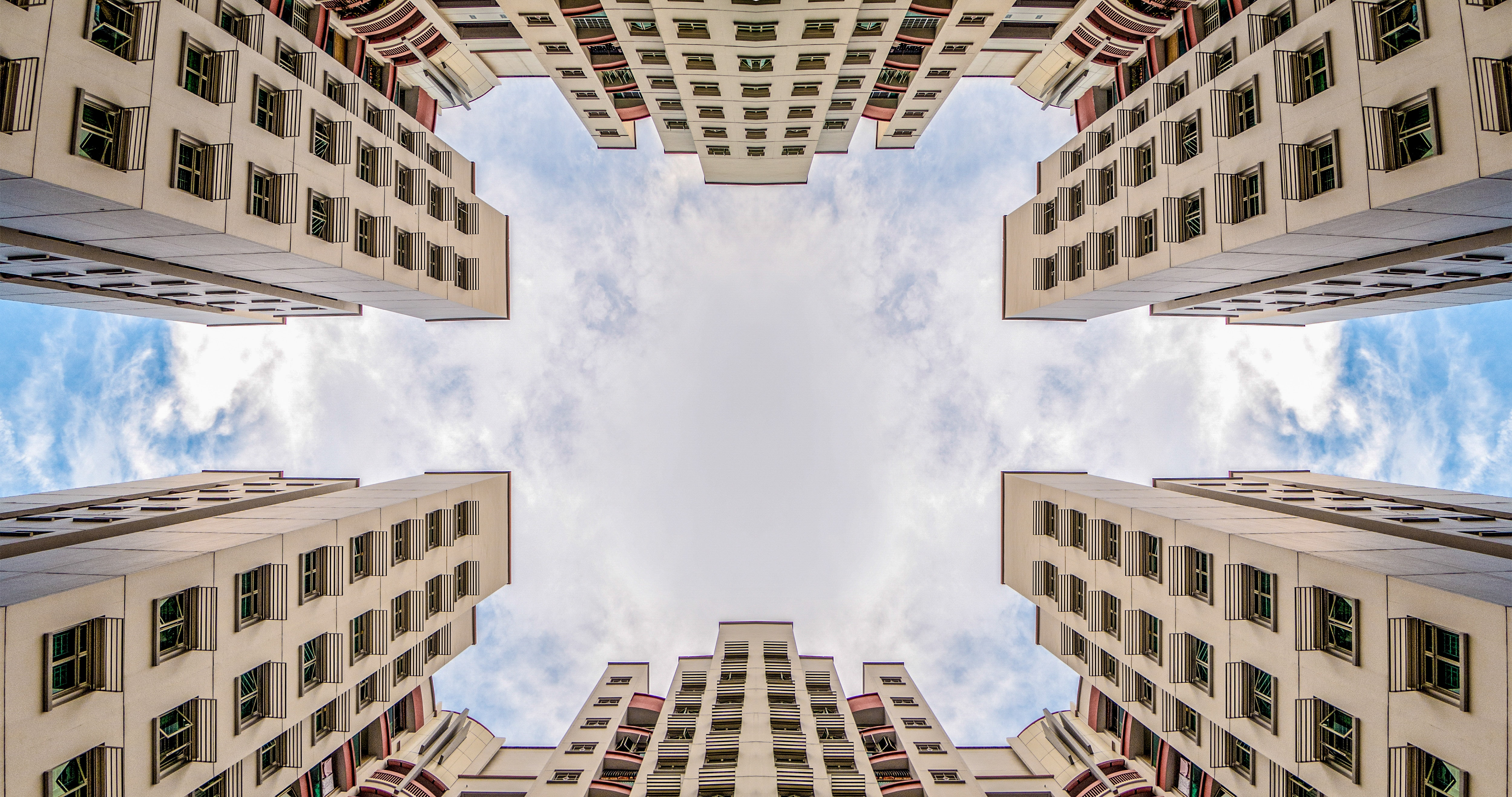 low angle photography of two white concrete buildings