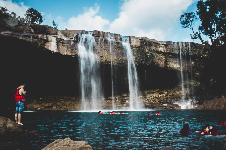 people in waterfalls
