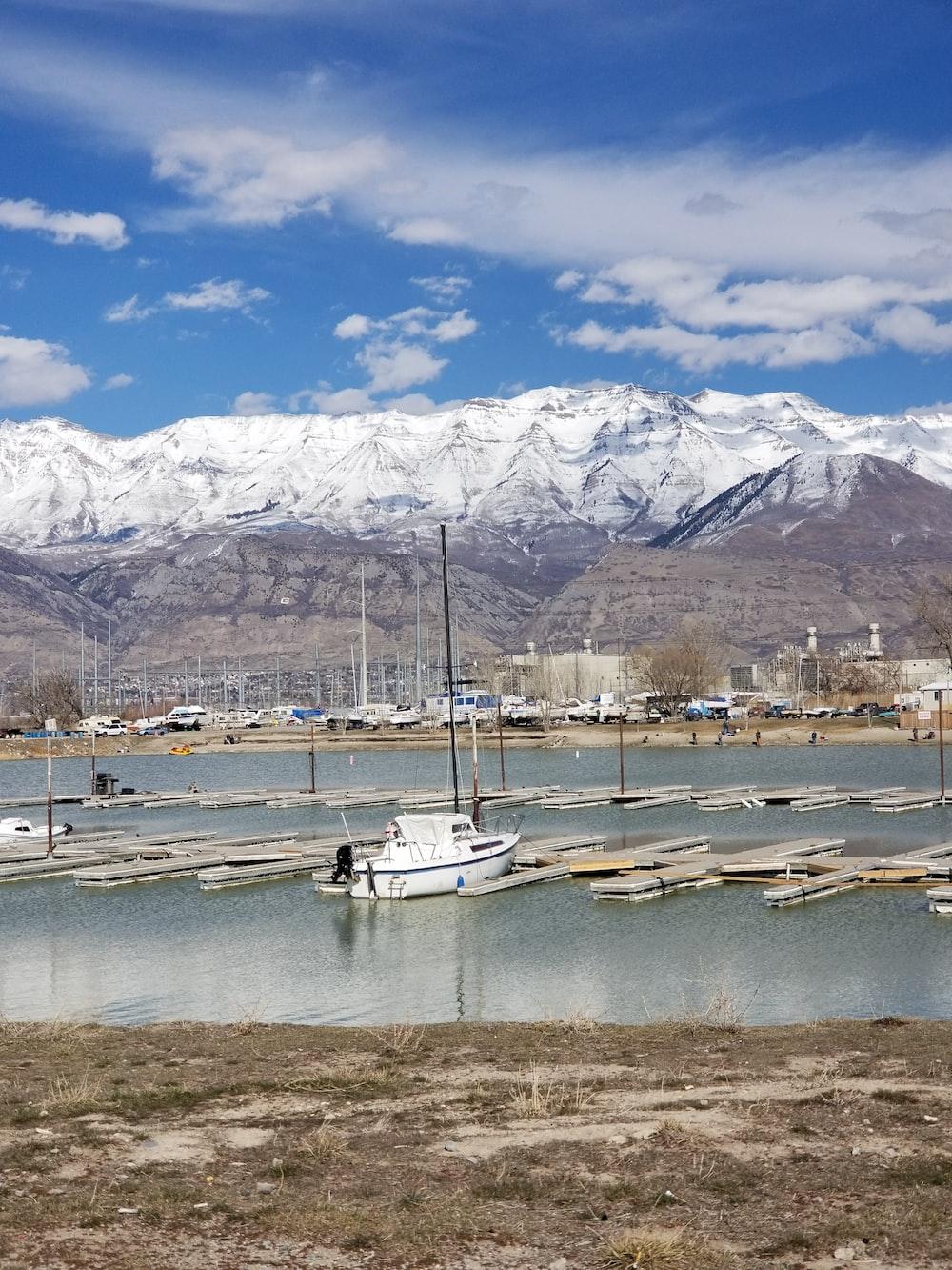 white yacht docking under blue sky