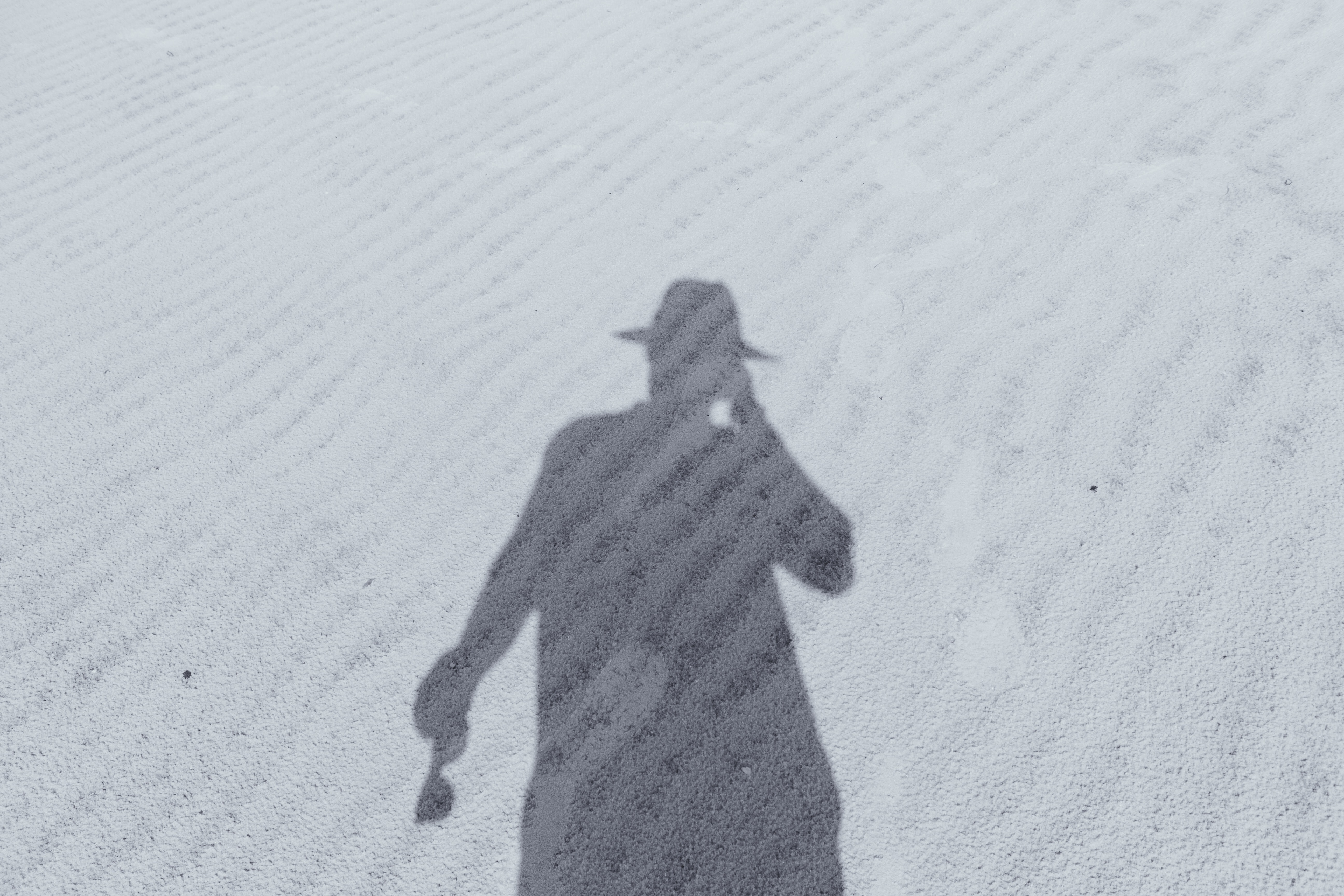 silhouette of man in hat