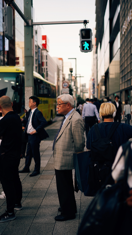 man in gray suit standing near traffic light