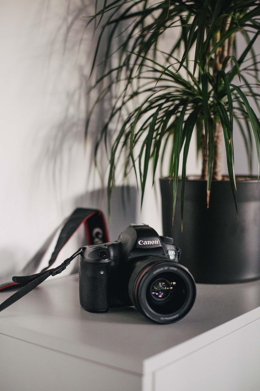 selective focus photography of black Canon DSLR camera