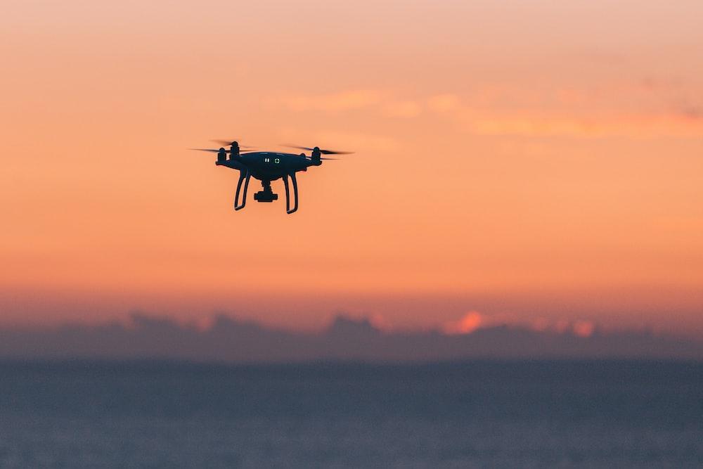 black quadcopter in sky