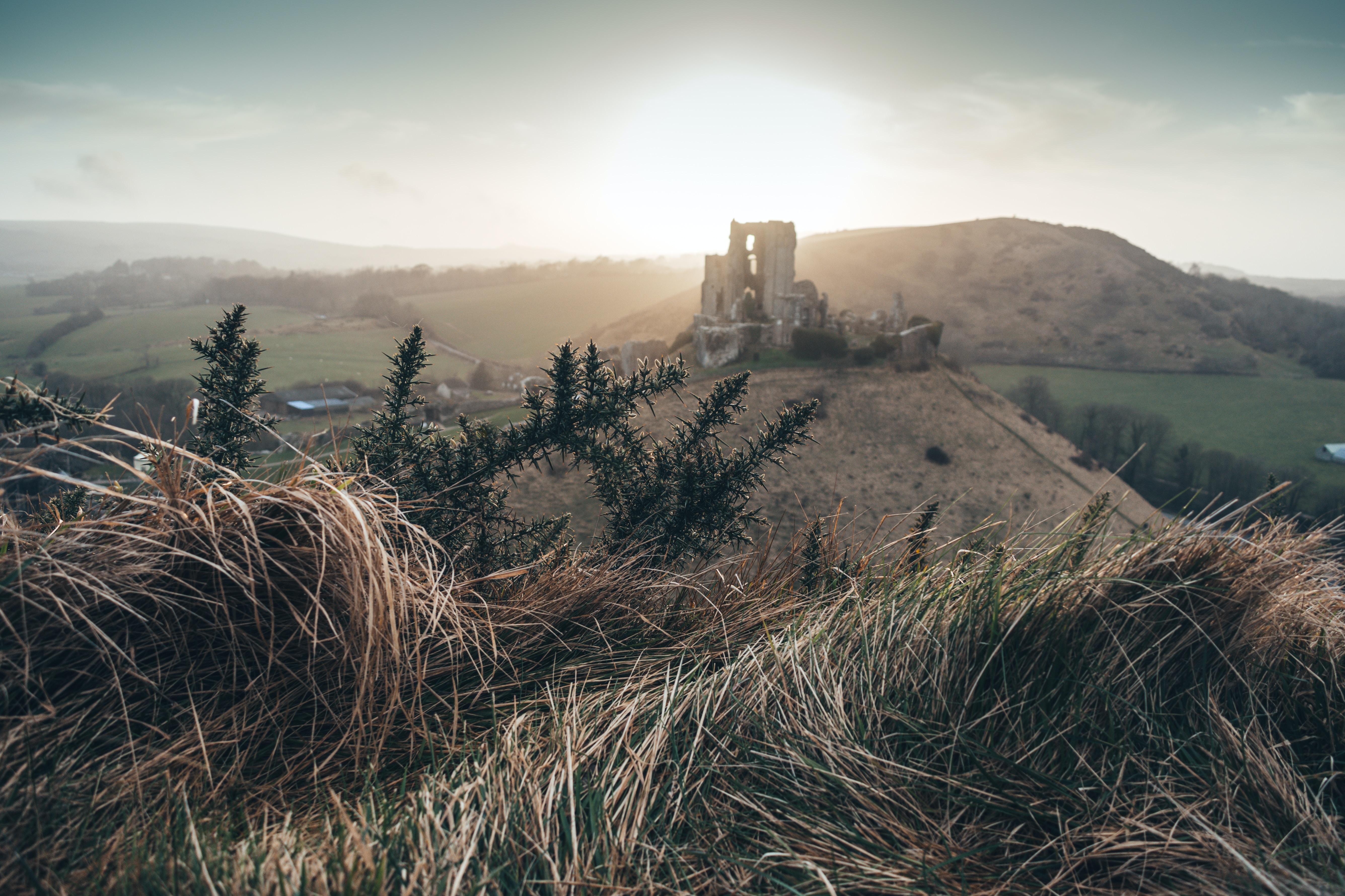castle on hill near lake