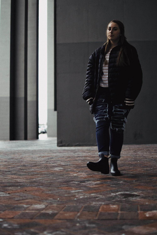 woman standing wearing black jacket