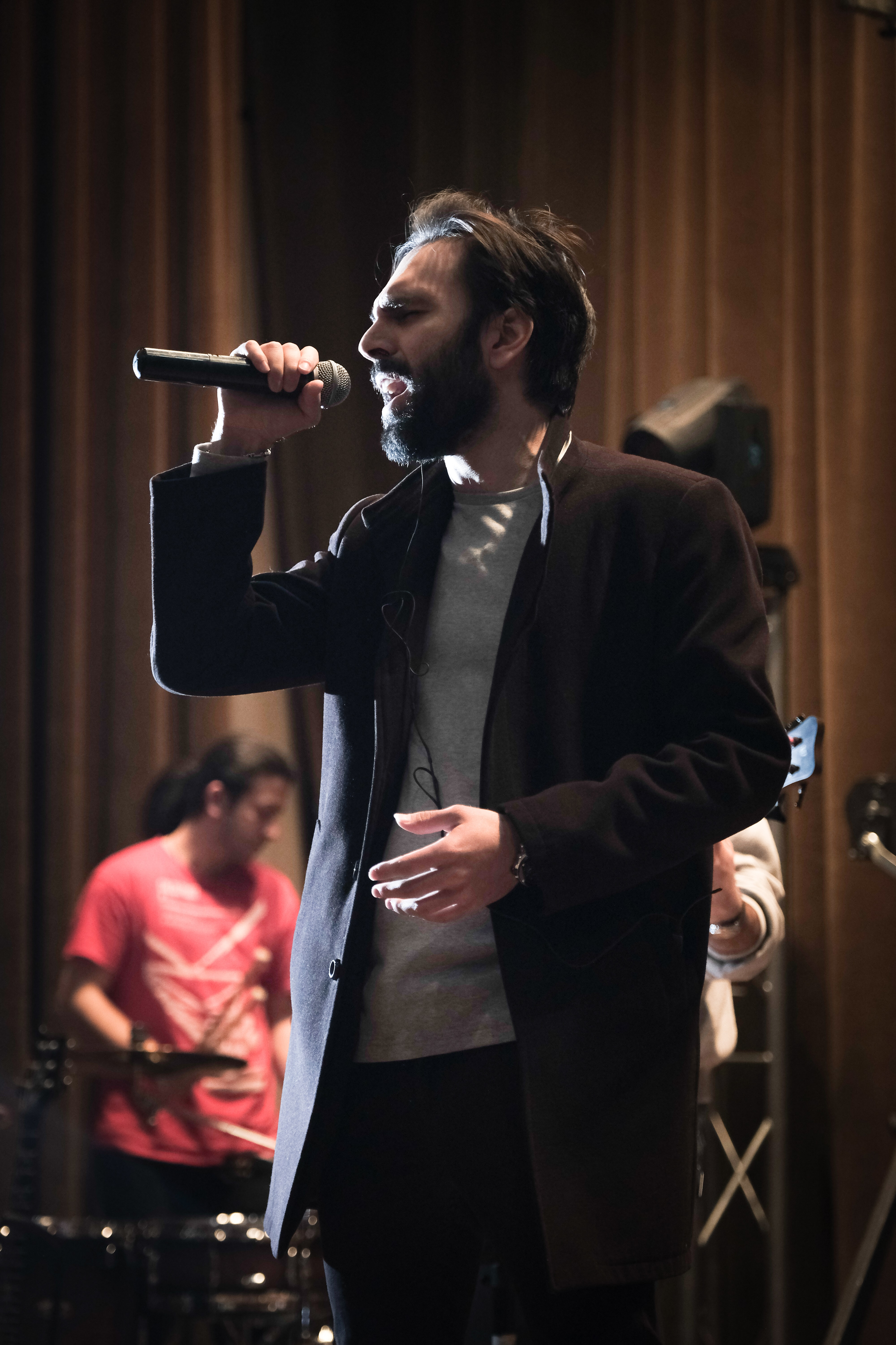 man singing while holding microphone