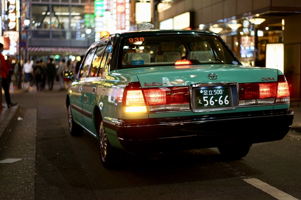 green Toyota sedan