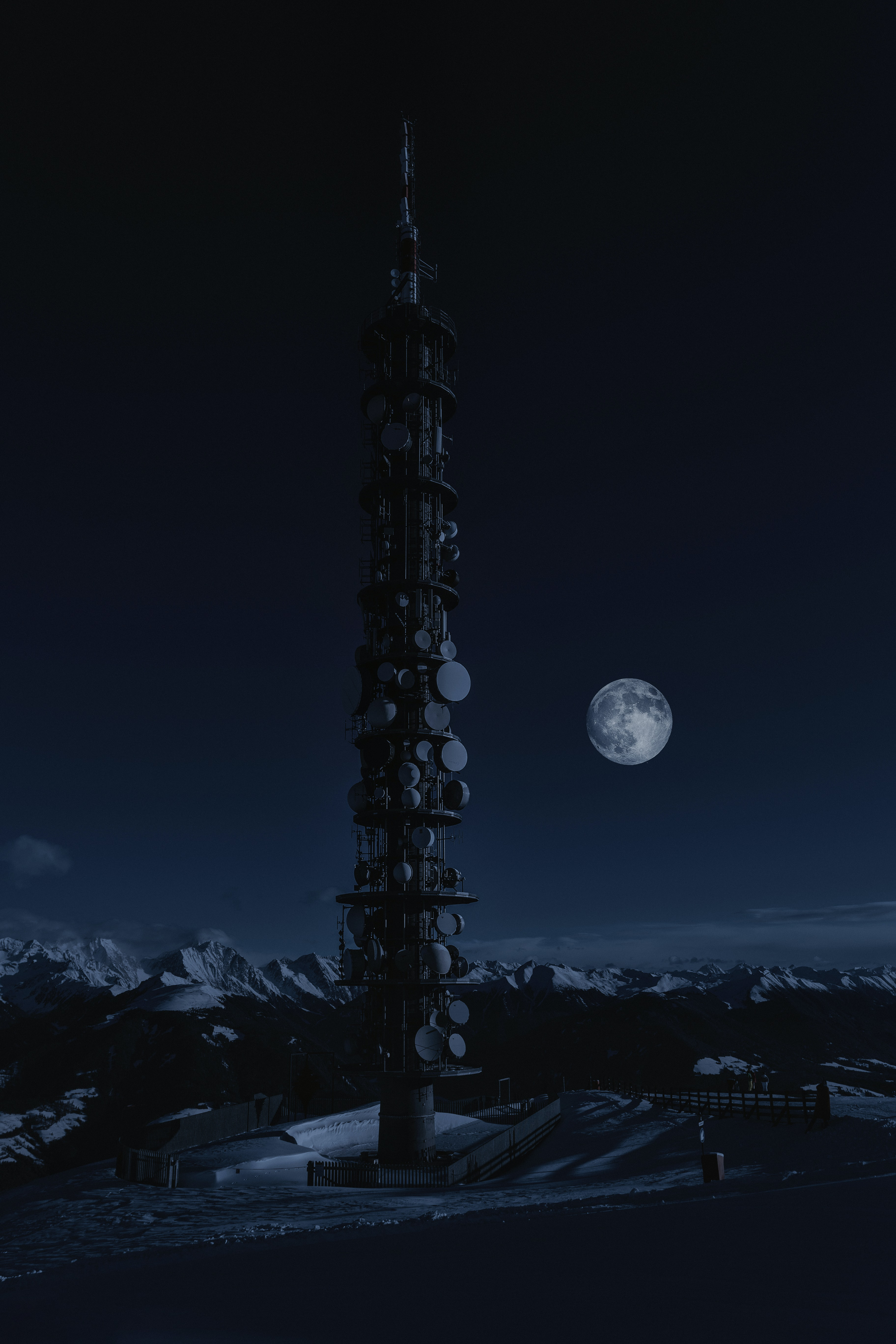 tower on snow under full moon