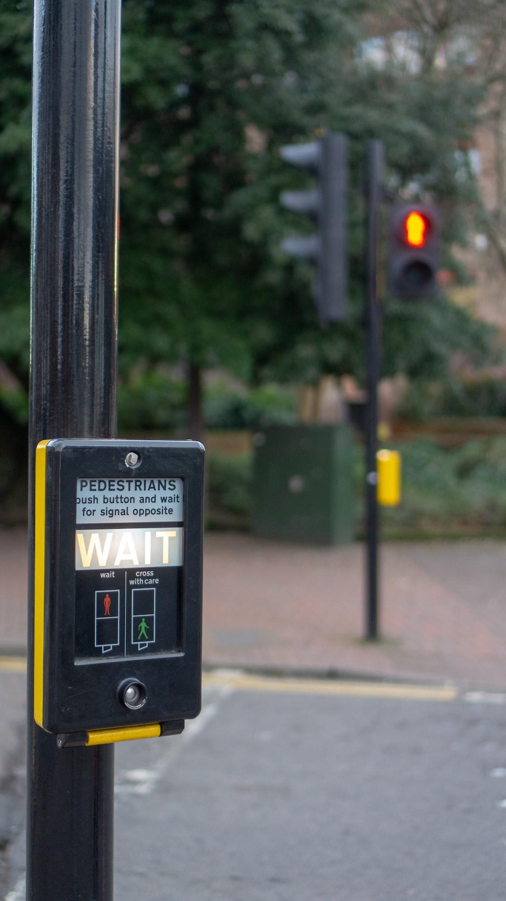 black and yellow stoplight monitor displaying wait