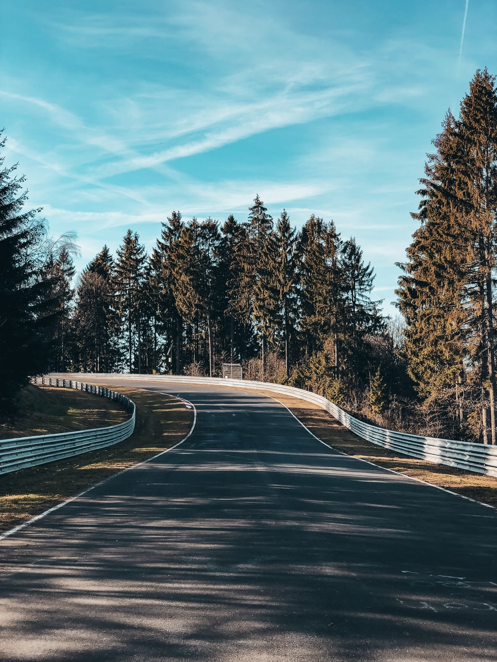 empty roadway under blue sky