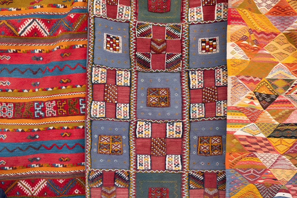 three assorted-color quilts