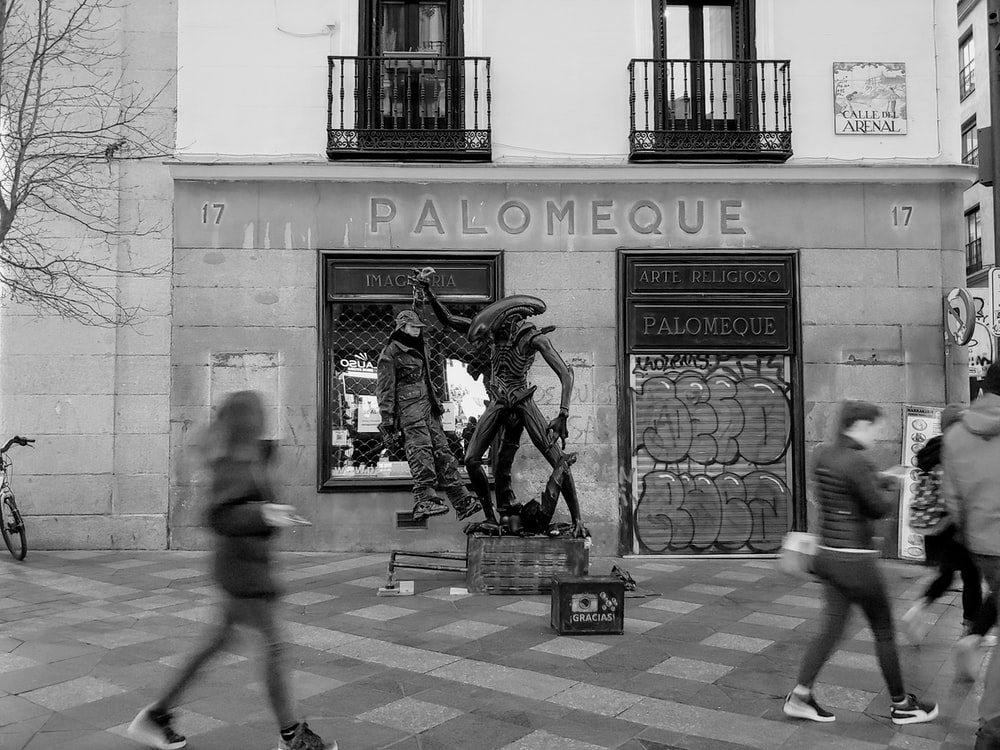 grayscale photography of Palomeque building