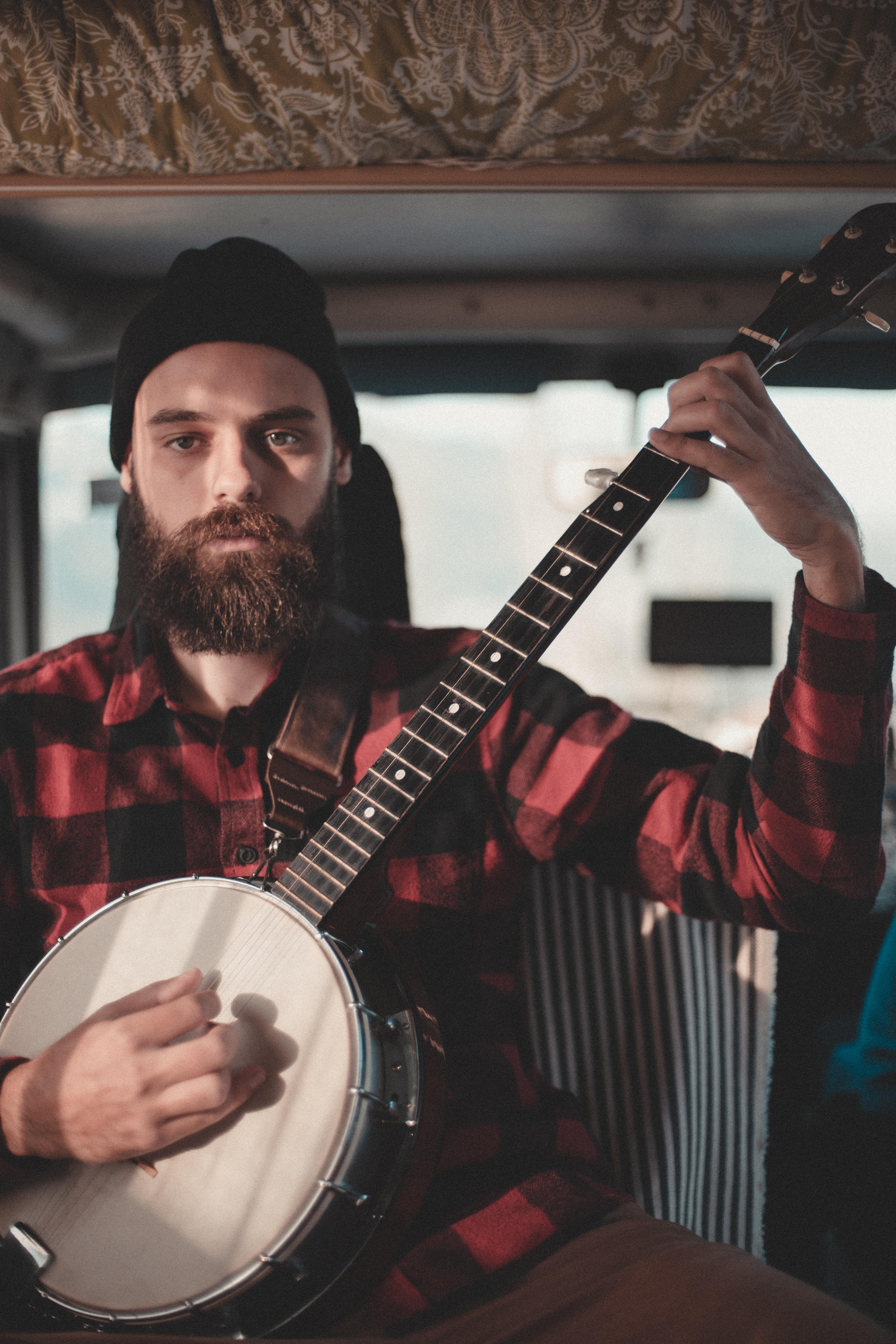 man holding string instrument