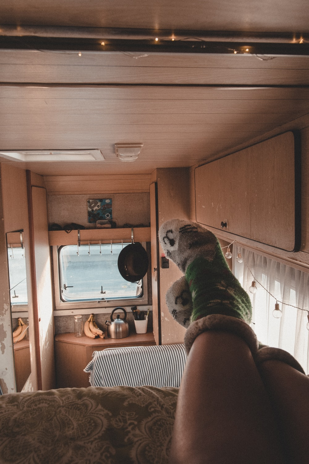 person in green-and-white cat socks in trailer
