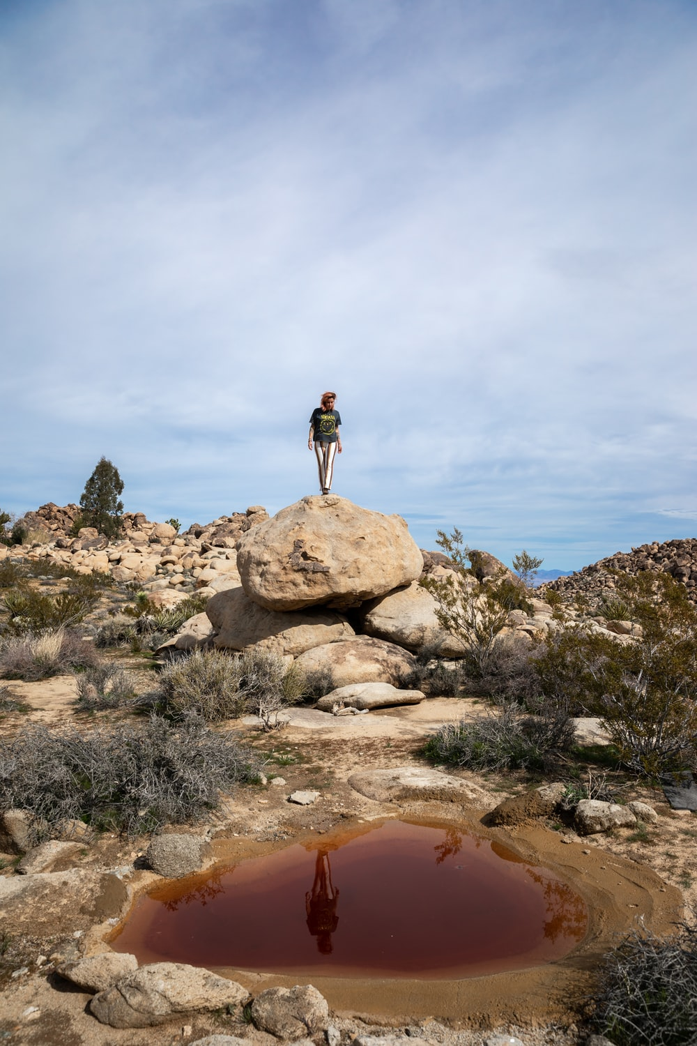 person standing on rock formation at daytime