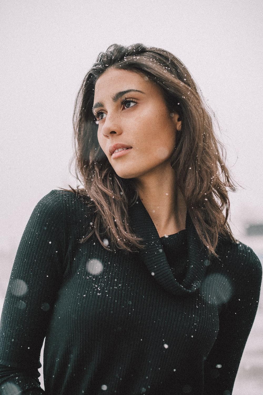 woman wearing black long-sleeved shirt on snow field