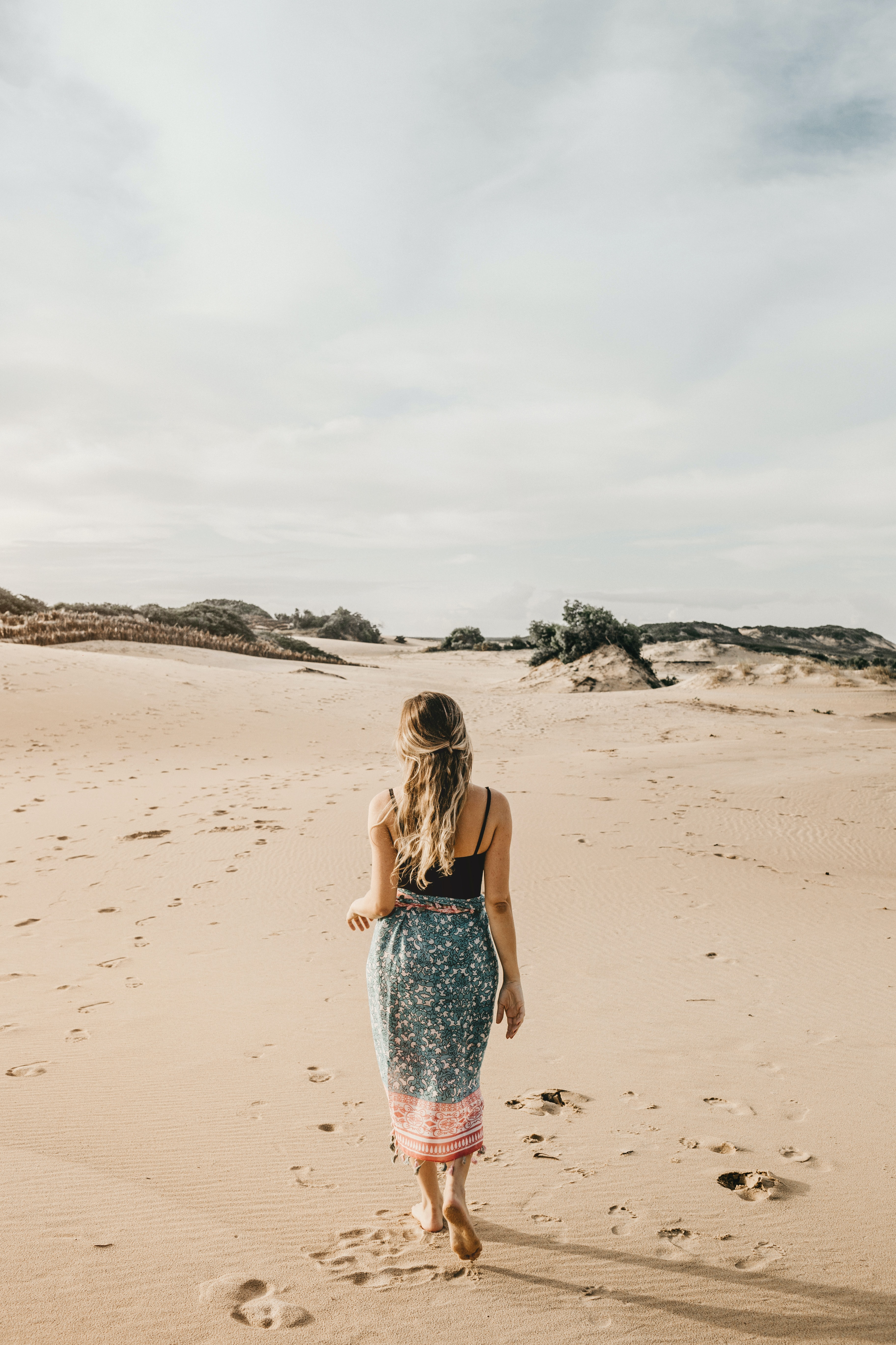 man woman standing on shore at daytime