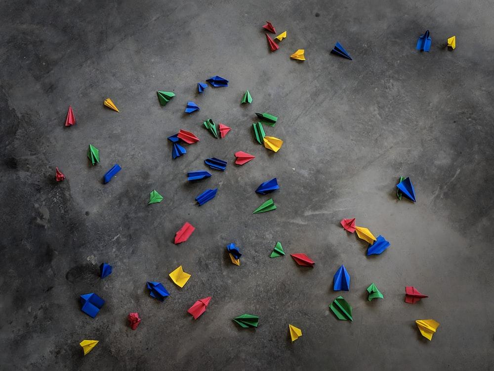 origamis on concrete pavement