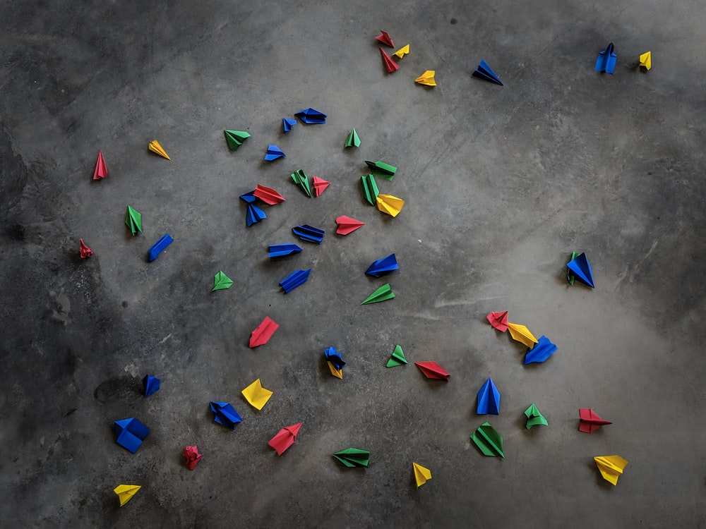 origamis on concrete pavement