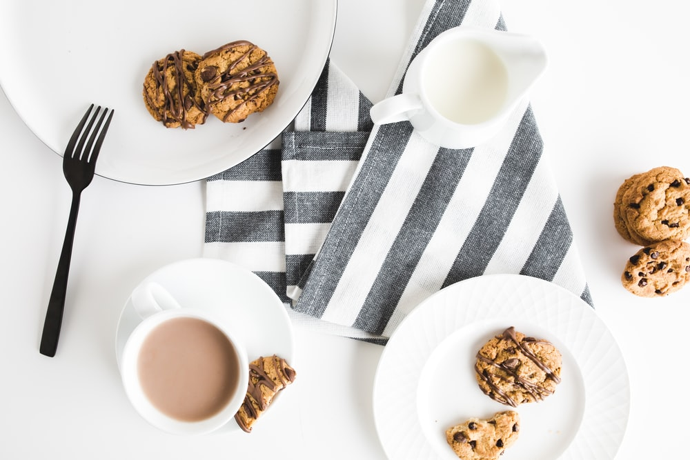 cookies on plates above gray and white textle