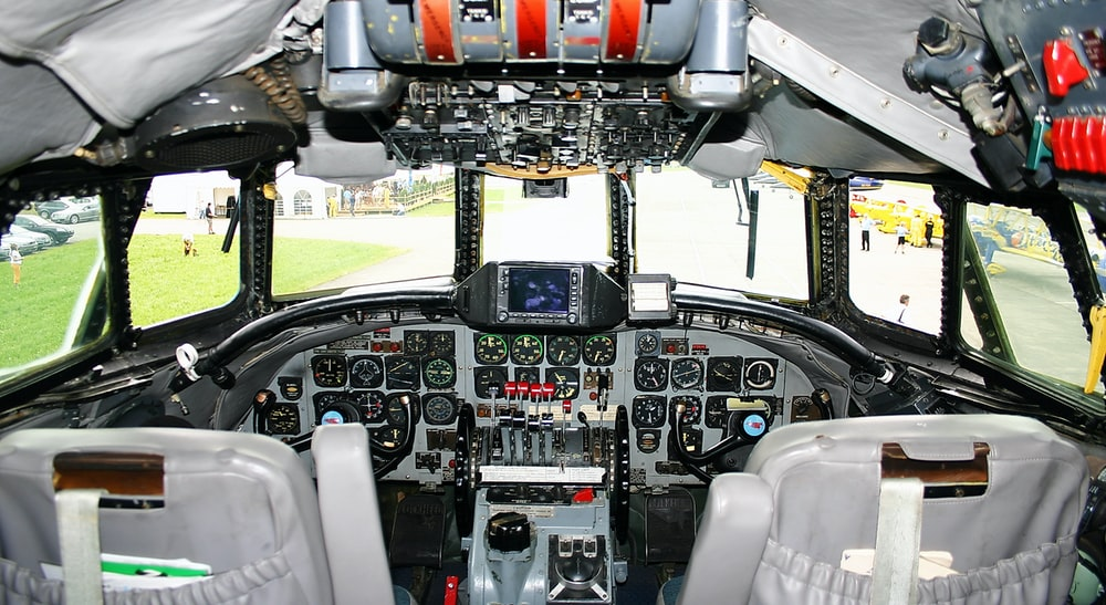 black and white interior view of planes driver's seat