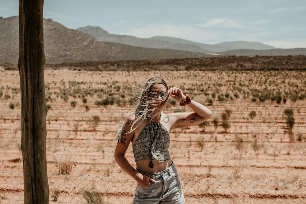 woman wearing gray top taking pose