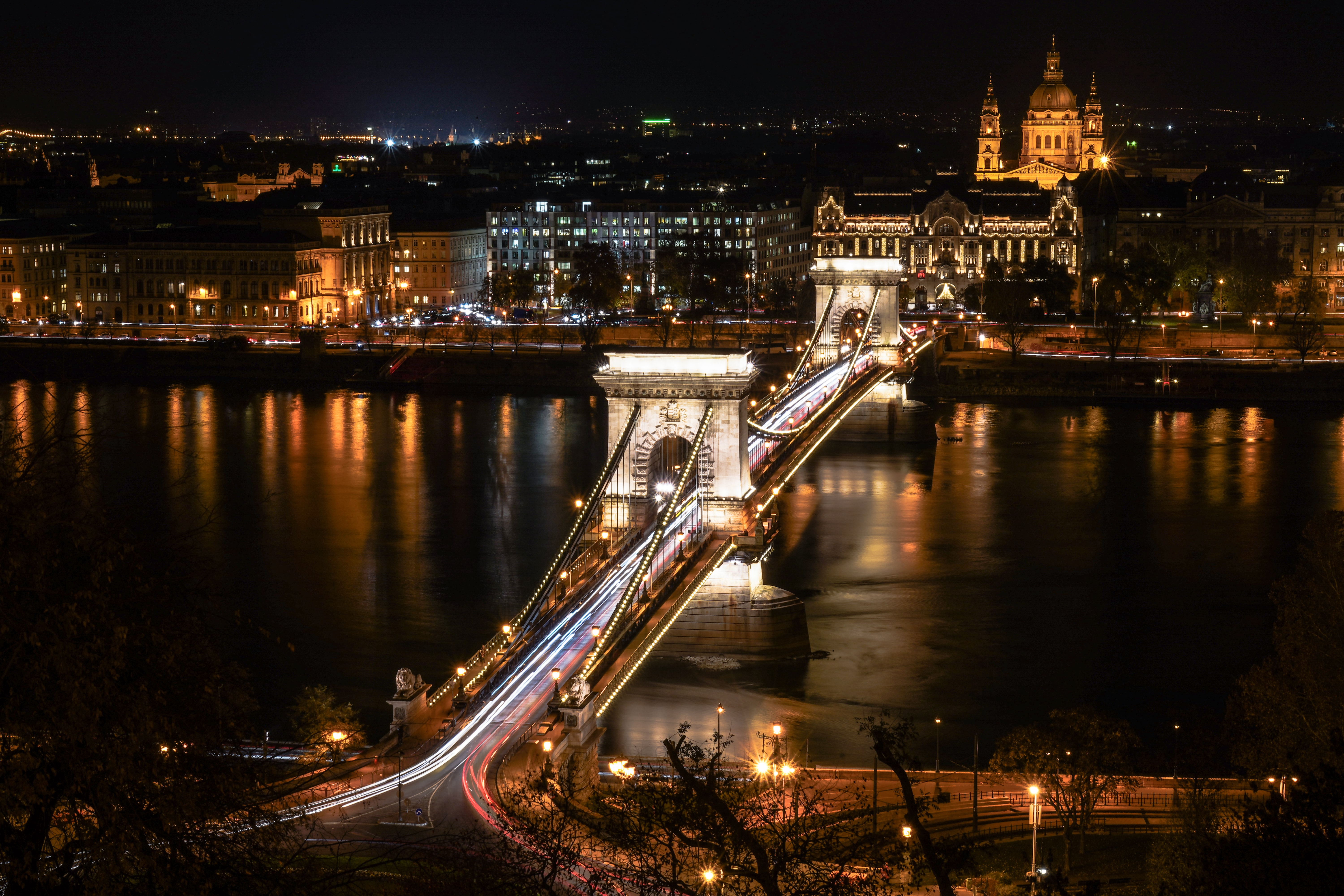time lapse photography of bridge during night time