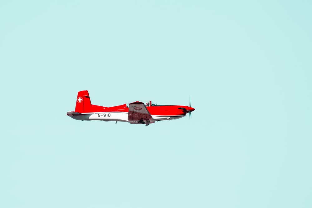 red and white aircraft
