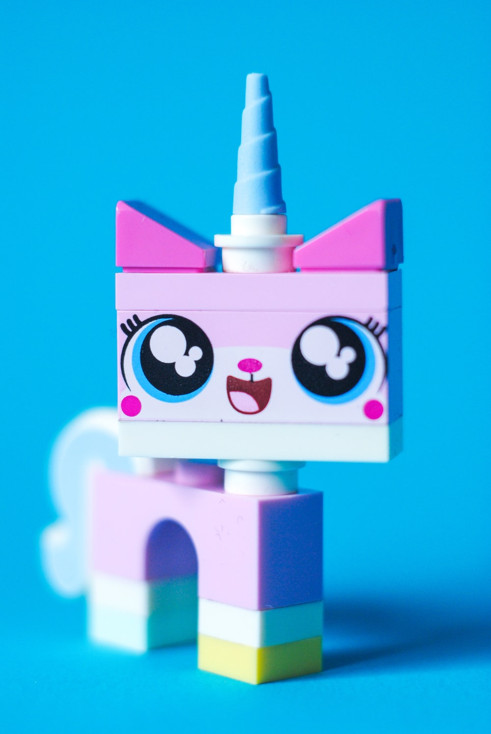 pink and white unicorn lego toy
